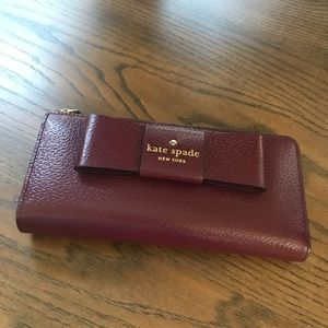 Kate Spade burgundy wallet with bow